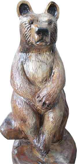 Chainsaw carved bear sitting on stump. Carved in 2015