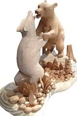 Carved in 2012 features two grizzly bears fighting.